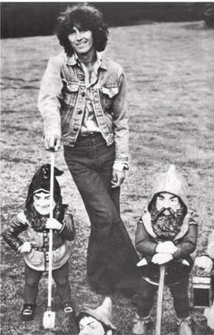 George Harrison and his famous gnomes from Friar Park.