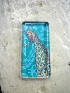A blue Peacock Beveled glass tile with metal by Mckeejewelrybeads, $9.50