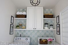 Updated laundry room with stenciled walls, DIY light and cabinetry
