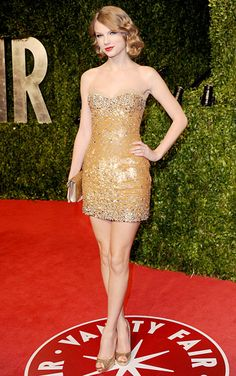 Taylor Swift In a gold and silver beaded strapless Zuhair Murad dress with Jimmy Choo platform sandals