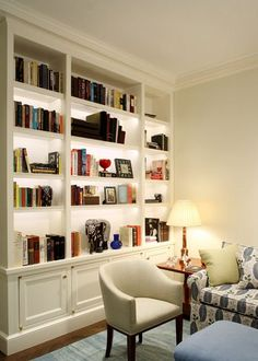 Small Home Library Design Ideas I love the storage on the bottom and book shelves on the top.