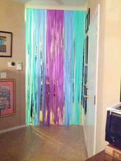 Easy party curtain! $7 tension rod with dollar store streamers! Tape streamers to the rod so they don't fall. EASY, FAST, & AFFORDABLE!