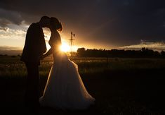 DIY Country Wedding kiss in the Colorado Sunset