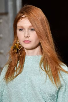 """The hair at the Tibi AW15 show speaks to fuss-free, effortless girls. """"We wanted to capture the randomness of when a girl takes off her sweater; a perfect mess"""" explained stylist Kevin Ryan who finished the look by spraying Unite Tricky Spray, a liquid wax, to the roots at the front of the head for matte shine, texture and hold.   - Cosmopolitan.co.uk"""