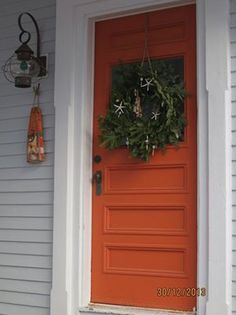 I like light grey, white trim and an orange door! (via Rebecca at New Canaan Kitchens)