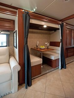 Winnebago Forza: Double Duty Dinette 	The intimate dinette folds into a spacious bunk bed setup.