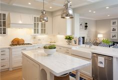Kitchen opens to family room. Kitchen peninsula fitted with a farmhouse sink and dishwasher