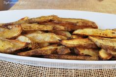 Spicy Oven Fries  http://www.sophisticatedyellow.com/outstanding-oven-fries-recipe/