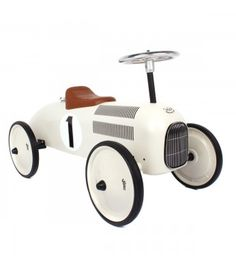 Stylish wooden ride-on toy car for kids two years old and up. I want one!