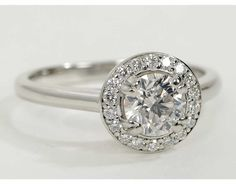 Halo Engagement Ring- this would be beautiful in rose gold paired with a pavé diamond eternity band