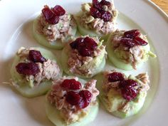 Tuna mixed with avocado and dried cranberries on top of fresh cucumber chips