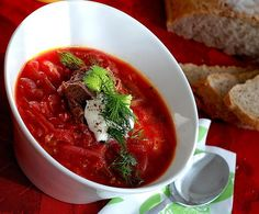 Russian borsch  with beef and sour cream. Home made ray bread on the background