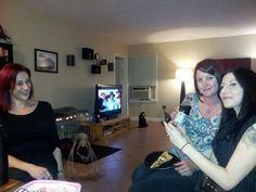 Strange form appears on birthday party photo: My daughter had her 33rd birthday party yesterday 12-12-12 and when she took a photo for me there was a strange figure on the floor that appeared on the