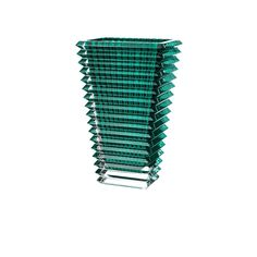 The wavy design of the crystal Eye vase comes from an extraordinary technique: exterior horizontal cuts and interior vertical cuts combine to produce a magic visual effect. Vase Cristal, Bottle Vase, Bottles, Crystal Vase, Tall Vases, Visual Effects, Vases Decor, Decorative Bowls, Cuff Bracelets
