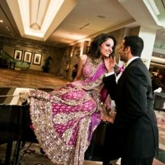 Gorgeous Indian bride in a purple lengha gown. Look at that smile!