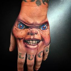 Chucky tattoo by Wes Hogan. Horror Movie Tattoos, Wicked Tattoos, Creepy Tattoos, Skull Tattoos, Love Tattoos, Beautiful Tattoos, Hand Tattoos, Tattoos For Guys, Evil Tattoos