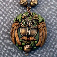 https://flic.kr/p/dymXfz | Polymer Clay Owl Pendant | This is a pendant I made with polymer clay in green and gold. It features a cute owl charm and my favorite brass acorn beads.