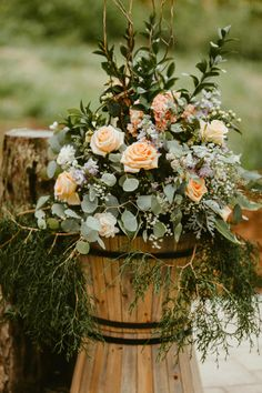 Peach roses, lavender flowers, wine barrels, flower arrangement for weddings // Candace Nicole Photography