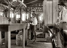"""January 1909. """"One of several youngsters I found in Tampa Cigar Box Factory. They are reported to have many children when work is rushing. About 10 young boys and girls, 300 employees.""""Photo by Lewis Wickes Hine."""