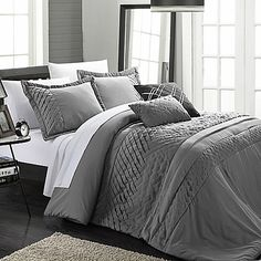 The Chic Home Claire 6-Piece Comforter Set features breath-taking pleats and ribbon detailing for a truly unique statement-piece. Complete your ensemble with the coordinating shams and decorative throw pillows with piecing, pleats, and ribbon detailing.