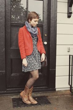 combat boots, polka dot tights, infinity scarf, blazer, floral dress, and pixie cut....shes really got it put together.