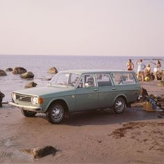 Family looking seaward to find something better than their Volvo wagon.  Couldn't.