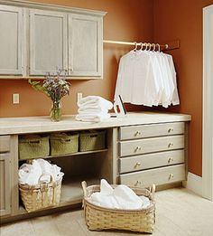 Lively laundry rooms - pole. Had a pole installed after seeing this picture. Keeping pin because there are many ideas and photos on the site.