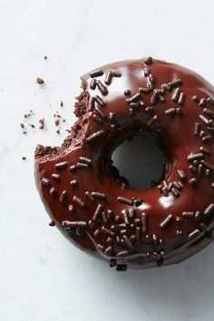 Chocolate Fudge Cake Doughnuts - Many of you have been wondering when we'd come up with a chocolate version of our popular baked doughnut recipe — and here it is. Moist, dense, and dark, these doughnuts are everything a chocolate lover could want. Baked Doughnut Recipes, Doughnut Pan, Baked Donuts, Doughnut Holes, Chocolate Fudge Cake, Chocolate Donuts, Chocolate Lovers, Chocolate Desserts, Chocolate Tarts