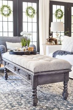 DIY Ottoman Bench from a Repurposed Thrift Store Coffee Table | blesserhouse.com - How to repurpose an old coffee table into a designer-inspired ottoman bench with tips for getting a faux weathered wood look and how to tuft upholstery #furnituremakeover #ottoman #coffeetable #oldfurniture