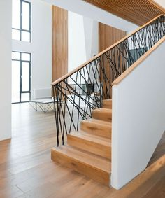 Wood staircase railings and wrought iron metal railing for steps stair ideas modern interior design st Indoor Railing, Metal Stair Railing, Interior Stair Railing, Stair Railing Design, Stair Decor, Staircase Railings, Railing Ideas, Metal Deck, Staircases