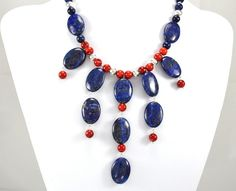 This lapis and red coral necklace is now available on Etsy in the QuirkyGirlzcom store. Browse more handmade jewelry at http://www.QuirkyGirlz.com http://www.facebook.com/QuirkyGirlz