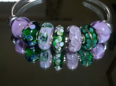Lilac and Green Should Always Be Seen...on a Bangle.  From a great UK collector on our Forum!  http://trollbeadsgalleryforum.ning.com/