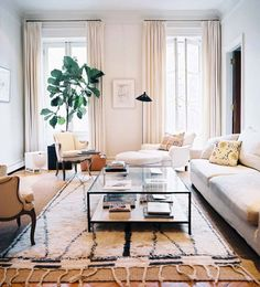 Layered rugs... Vintage Beni Ourain Rug over natural rug