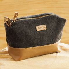 Black Wool Felt & Faux Leather Travel, Cosmetic Pouch. https://www.qtrove.com/products/black-wool-felt-faux-leather-travel-cosmetic-pouch Hand-crafted with leather & imported wool, a very convenient size for storage. https://www.qtrove.com/products/black-wool-felt-faux-leather-travel-cosmetic-pouch