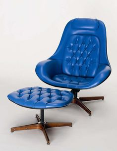 George Mulhauser's 'Plycraft' Lounger and Ottoman with rare original blue leather upholstery and laminated walnut frame.    Mulhauser is also credited for designing the 1955 Coconut Chair for the George Nelson Studios