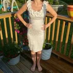 Pretty white dress with ruffle neckline Worn once for my wedding rehearsal. Figure flattering and very feminine. Maggy London Dresses