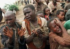 Innocent children forced to watch the death of their parents ... Rwandan genocide, 1994