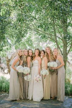 A bridal party clad in Adrianna Papell: http://www.stylemepretty.com/little-black-book-blog/2014/12/03/rustic-chic-chalk-hill-winery-wedding/ | Photography: Matt Edge - http://mattedgeweddings.com/