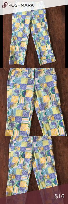 Lilly Pulitzer Capris-Size 4 Great Condition Lilly Pulitzer Giraffe and Lion Print Cotton /Spandex Capris-Size 4.  From clean and smoke free home. Waist 15 inches across laying flat  Hips 18 inches across laying  Inseam 22 inches Lilly Pulitzer Other
