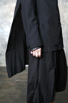 Yohji Yamamoto Fall/Winter 2013 - Minimalist in detail, Yamamoto creates movement through layering to highlight the detailing behind. Credit: unknown