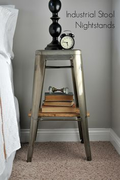 DIY Industrial Stools turned into functional nightstands. We added a removable wooden plank shelf that doubles as a tray! www.littleglassjar.com