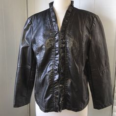 """AWESOME SOFT FAUX LEATHER JACKET. GORGEOUS  FAUX LEATHER JACKET with Ruffles.  21"""" Length from Top of Shoulder to Hemline.  22 1/2 """" measures flat across Bustline. 22"""" Sleeve.  2 Front Zipper Pockets. Double Stitching in Front and Sleeves to give a Tailored  Look.  100 % Polyurethane and Viscose.  RUFFLE  ZIPPER FRONT IS ADORABLE. Giacca Jackets & Coats Blazers"""