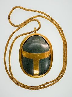 Heart Scarab of Hatnefer, engraved with a text from the Book of the Dead  Upper Egypt, ca. 1492–1473 B.C. (New Kingdom, early Dynasty 18)  Serpentine and gold, scarab 6.6 cm long (2 5/8 in)