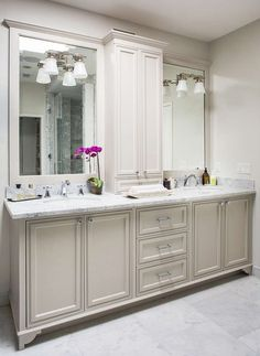 Gorgeous+master+bathroom+features+a+light+grey+double+vanity+adorned+with+polished+nickel+knobs+...