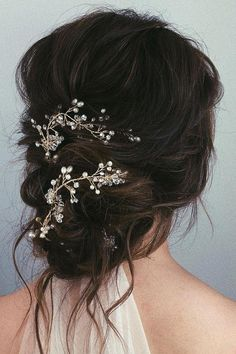 Bridal Hairstyle. Love this loose bun with some decoration. Perfect on dark brown hair #wedding #weddings #inspiration #ideas Catherine Kentridge, Celebrant #uniqueweddinghairstyles