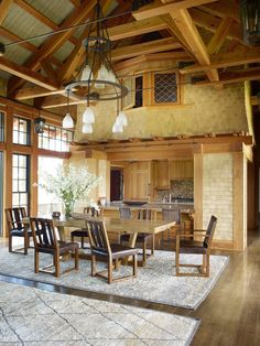 The core of the house—the great room, which combines living and dining areas and an open kitchen—retains the rustic character of a park lodge,Nothing expresses this more palpably than the Alaskan yellow cedar shingles on the walls, which provide texture and scale