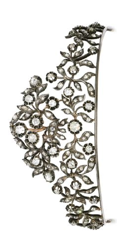 Diamond diadem, late 19th century Of floral and foliate design, set with cushion-shaped, circular-cut and rose diamonds, front top section detachable and may be worn as a brooch. http://www.sothebys.com/en/auctions/ecatalogue/2014/fine-jewels-l14052/lot.429.html