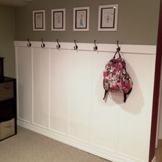 The beginnings of my new mudroom area! <3 The photos are portraits of everyone in the family done by my daughter!