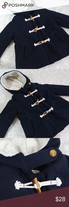 OshKosh B'gosg Padded Blue Toddler Coat Sz 5T Adorable blue coat with lined hat.  Padded and warm with toggle closures.  Size 5T.   Bundle your likes for a private offer or make an offer!  All reasonable offers accepted.  Thank you for shopping my closet!  :0) OshKosh B'gosh Jackets & Coats Pea Coats