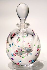 Controlled Bubble Perfume Short by Roger Gandelman, who mixes precious metals (gold & silver), or rare oxides (cobalt & copper) with molten glass at temperatures of 2300 degrees to attain radiant colors